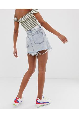 9752e4e1035 Голубая джинсовая юбка на молнии Bershka - Синий