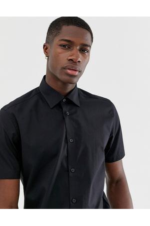 6c854325cb9 Эластичная черная приталенная рубашка с короткими рукавами Esprit - Черный